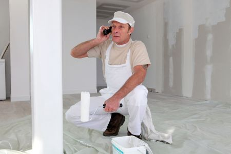 Hard-working painter talking to his client